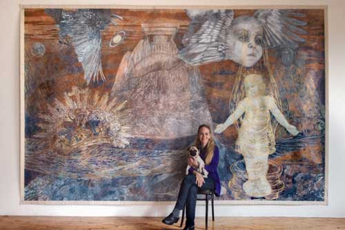 "Ann MCoy, ""Lunar Birth"" with the artist, 2001. Pencil on paper on canvas, 9 by 14 ft."