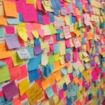 "Jennifer Bartlett, A few days after the election a pop-up artist/therapy piece began growing in the Union Square subway station. Passersby were encouraged to write a message to the world [in response to the election] on a ""sticky note."""